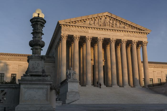 In this Nov. 6, 2020, file photo, the Supreme Court is seen at sundown in Washington.
