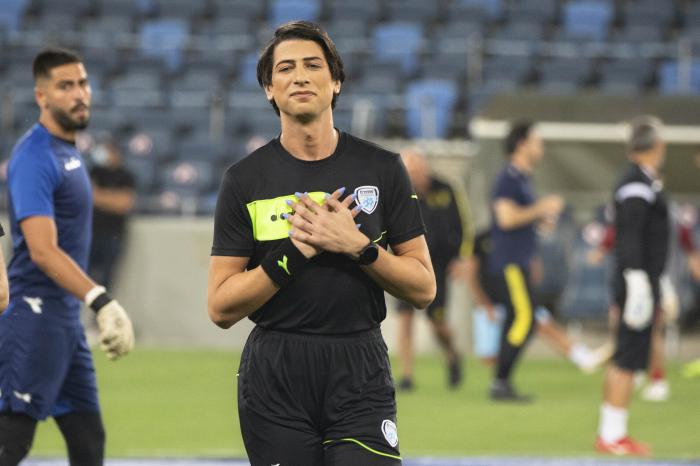 Referee Sapir Berman attends a warm-up before an Israeli Premier League soccer match between Hapoel Haifa and Beitar Jerusalem in the northern Israeli city of Haifa.