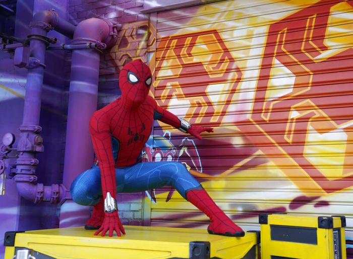 """A Spider-Man character poses for guests following """"The Amazing Spider-Man!"""" show at the Avengers Campus."""