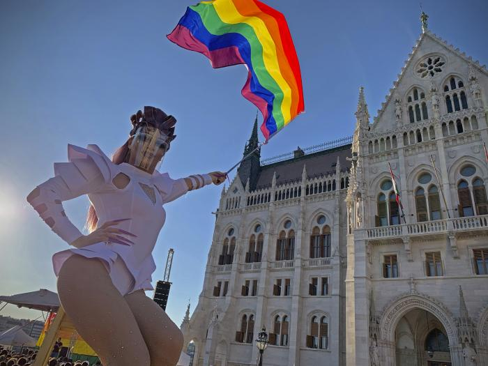 A drag queen waves a rainbow flag during an LGBT rights demonstration in front of the Hungarian Parliament building in Budapest, Hungary.