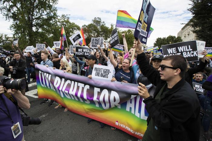 Supporters of LGBTQ rights stage a protest on the street in front of the U.S. Supreme Court in Washington.