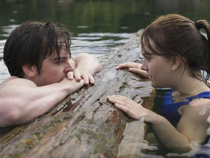 This image released by Apple TV+ shows Ferdia Walsh-Peelo, left, and Emilia Jones in a scene from 'CODA.'