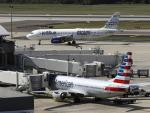 US Sues to Stop Deal Between American Airlines and JetBlue